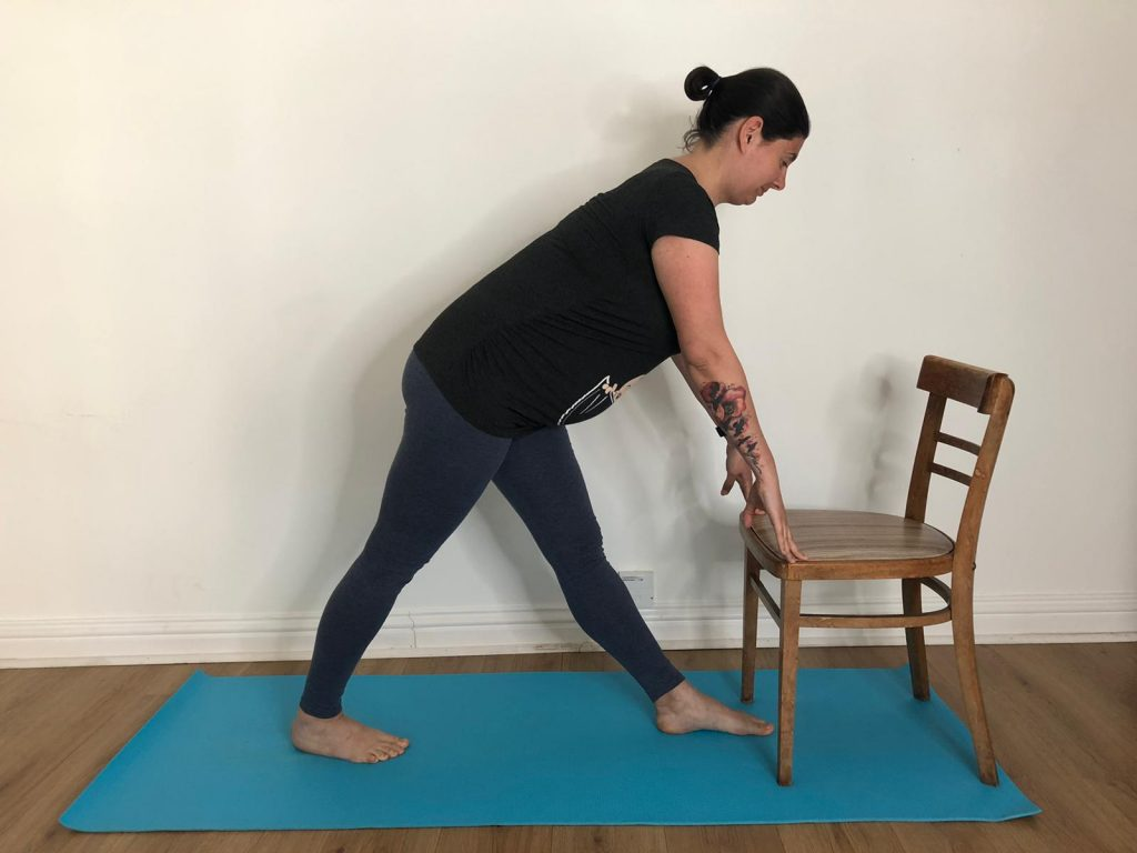 using a chair for forward fold